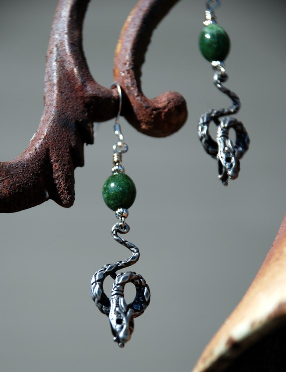 Deathly Hallows Nagini Earrings by kittykat01 on deviantART And if you message her on etsy, she might be able to make you a pair. :)