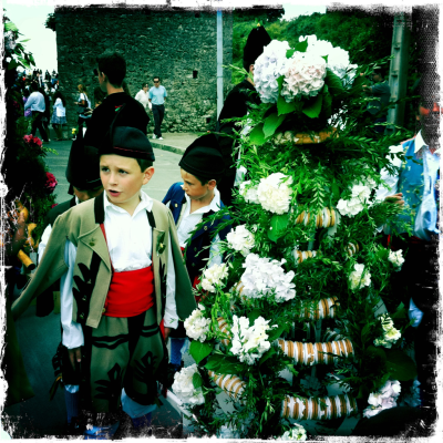 "Día de San Roque en Llanes. Saint Roque's festivity in Llanes The summer festivities in Llanes are organised in ""Bandos"": Saint Roque (16th of August), the Virgen de la Guia (8th of Septembre) and Saint Magdalena (22nd of July). There is a fierce rivalry between the different bandos. Every year they compete to be the village's best festivity. San Roque is the patron saint of pilgrims, male nurses and dogs. The official pasodoble of the bando of Saint Roque is ""España cañí"" and their flower is the siempreviva."