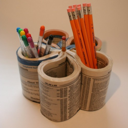 shizandgiggles:  Recycle a phone book into a pen holder!