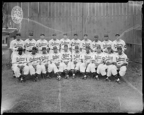 Baltimore Elite Giantsca. Late 1930sPhotograph by Paul S. Henderson (1899—1988)8 x 10 inch black and white negativeHenderson CollectionMaryland Historical SocietyHEN.09.10-016  The Baltimore Elite Giants were a baseball team that played professionally in the Negro Leagues from 1920 until 1950.  One section of the Henderson Collection is made up of a few hundred 8 x 10 inch black and white acetate negatives, mostly produced in 1937-1939. The white lines that appear in this photograph is called channeling, which is a common characteristic of acetate film as the film ages or is exposed to a warm climate.