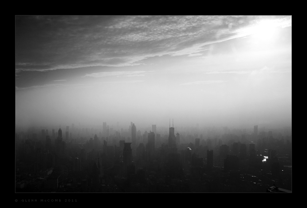 Shanghai Smog Smog rests over Shanghai as the afternoon sun descends. This shot was taken from the observation deck of the Jin Mao tower.