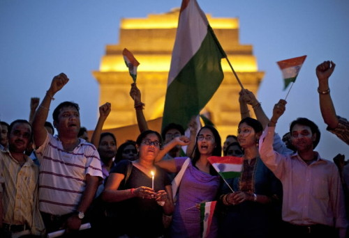 washingtonpoststyle:  Today, in one image. Supporters of India's prominent anti-corruption crusader Anna Hazare gather near the India Gate memorial in New Delhi. Photo by Kevin Frayer (AP)