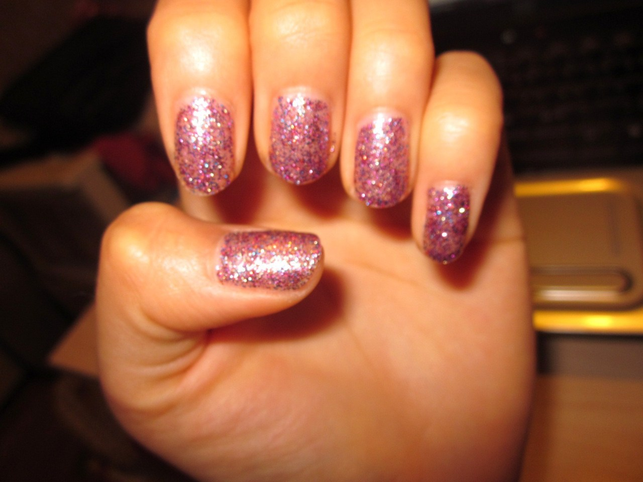 "camera kinda sucks at capturing them, BUT here are my sparkly nails~ hehe katy perry's ""firework"" song inspired me to get this glittery color ^.^"
