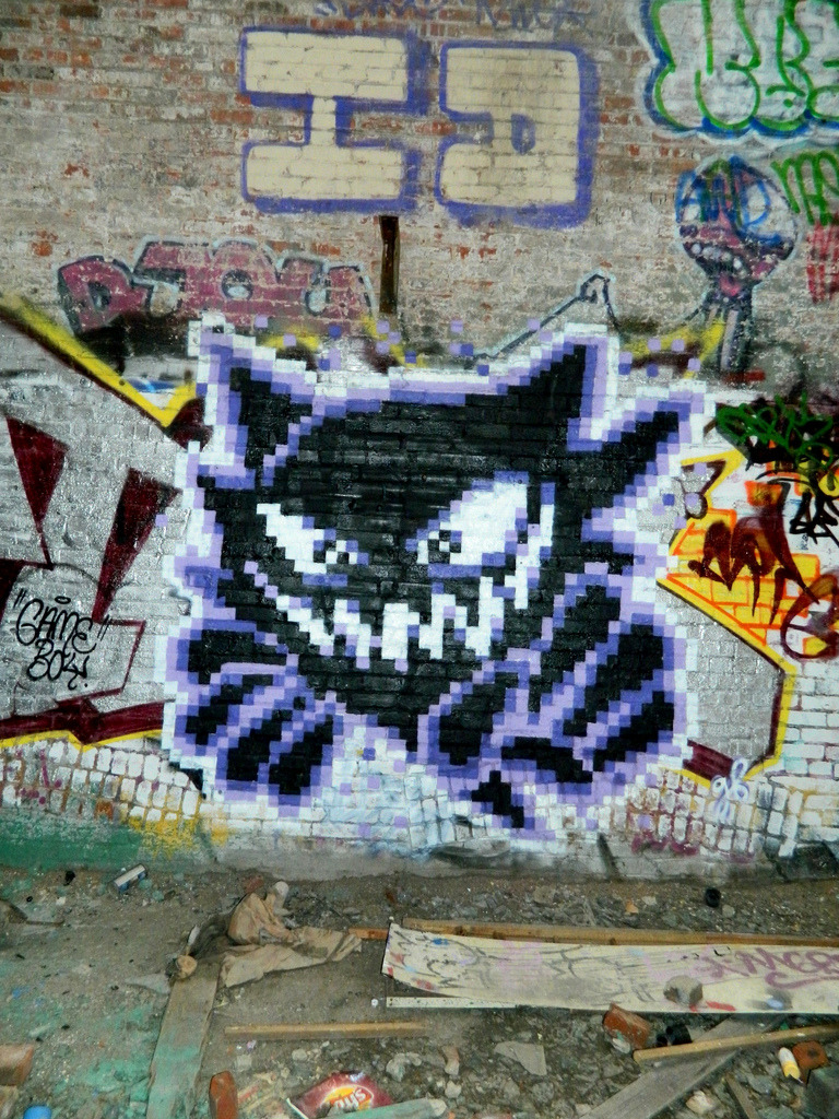 albotas:  Daily Graffiti: Haunter pixel graffiti by gameboyone. Glad to see her doing more Pokémon pieces. If you haven't already, check out our interview with gameboyone RIGHT HERE! Check out the Daily Graffiti Archives for more geektastic street art!
