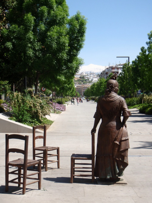 Spanish woman with chair in Granada, Spain.