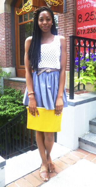 Martika, an assistant manager at our Newbury Street store is wearing the Full Woven Skirt in Blue Chambray, Eyelet Tank in White, Vintage belt and shoes, and a Leather Carry-All in Bright Yellow.
