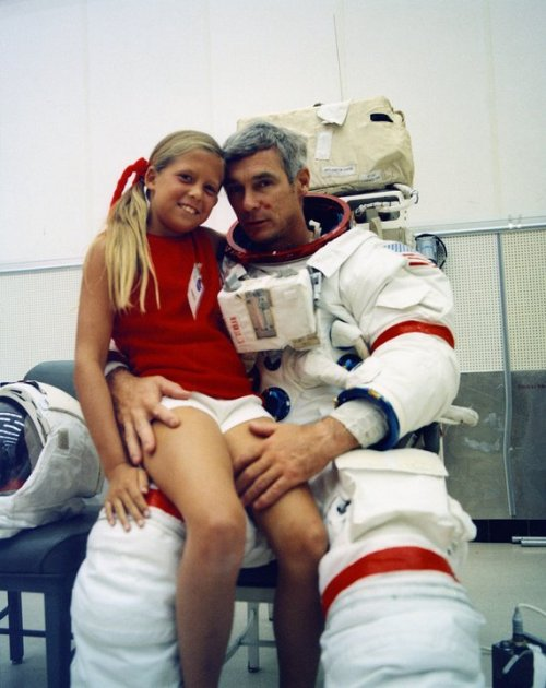 Apollo 17 mission commander Eugene Cernan takes a break from EVA training to pose with daughter Tracy. Photo taken at KSC on August 4, 1972.