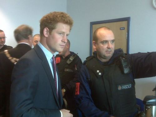 Prince Harry with officers today talking about the London Riots