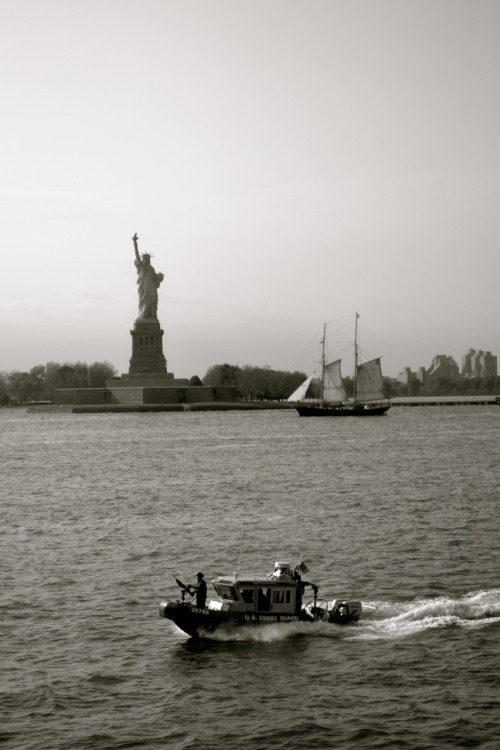 Lady Liberty with clipper ship and Coast Guard escort Photographed by Jennifer Weber from the Staten Island Ferry on May 13, 2011 New York, New York