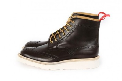 "Nitty Gritty X Tricker's Brogue Boots ""The timeless craft of Britsh label Tricker's has enjoyed incredible success in recent seasons, creating go-to silhouettes embodying both style and quality. The Nitty Gritty Store collaborates with Tricker's, designing this Brogue Boot. Smooth espresso barnished leather defines this boot with fine stitching, Telason laces, a red pull in the back and Vibram wedge sole. Grab a pair now for $686 USD at Nitty Gritty."""