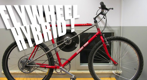 "Flywheel Hybrid Bicycle Brings F1 Tech to the Bike Lane | Gas 2.0 The bike you see here has been rigged up with a 15 lb. automotive  flywheel that's mated to a CVT, which allows the rear wheel to transfer  kinetic energy to the flywheel under ""braking"", effectively slowing the  bike down.  Once the cyclist is ready to pick up speed again, the CVT is  shifted the other way, and the spinning mass of the flywheel ""boosts""  the rider's legs and provides forward motion – just like the flywheel  KERS systems proposed by Williams F1 (which provides flywheel hybrid  tech to Porsche) and Volvo. The  bike you see here has been rigged up with a 15 lb. automotive flywheel  that's mated to a CVT, which allows the rear wheel to transfer kinetic  energy to the flywheel under ""braking"", effectively slowing the bike  down.  Once the cyclist is ready to pick up speed again, the CVT is  shifted the other way, and the spinning mass of the flywheel ""boosts""  the rider's legs and provides forward motion – just like the flywheel KERS systems proposed by Williams F1 (which provides flywheel hybrid tech to Porsche) and Volvo. Source: Gas 2.0 (http://s.tt/133pI) The  bike you see here has been rigged up with a 15 lb. automotive flywheel  that's mated to a CVT, which allows the rear wheel to transfer kinetic  energy to the flywheel under ""braking"", effectively slowing the bike  down.  Once the cyclist is ready to pick up speed again, the CVT is  shifted the other way, and the spinning mass of the flywheel ""boosts""  the rider's legs and provides forward motion – just like the flywheel KERS systems proposed by Williams F1 (which provides flywheel hybrid tech to Porsche) and Volvo. Source: Gas 2.0 (http://s.tt/133pI) The  bike you see here has been rigged up with a 15 lb. automotive flywheel  that's mated to a CVT, which allows the rear wheel to transfer kinetic  energy to the flywheel under ""braking"", effectively slowing the bike  down.  Once the cyclist is ready to pick up speed again, the CVT is  shifted the other way, and the spinning mass of the flywheel ""boosts""  the rider's legs and provides forward motion – just like the flywheel KERS systems proposed by Williams F1 (which provides flywheel hybrid tech to Porsche) and Volvo. Source: Gas 2.0 (http://s.tt/133pI) The  bike you see here has been rigged up with a 15 lb. automotive flywheel  that's mated to a CVT, which allows the rear wheel to transfer kinetic  energy to the flywheel under ""braking"", effectively slowing the bike  down.  Once the cyclist is ready to pick up speed again, the CVT is  shifted the other way, and the spinning mass of the flywheel ""boosts""  the rider's legs and provides forward motion – just like the flywheel KERS systems proposed by Williams F1 (which provides flywheel hybrid tech to Porsche) and Volvo. Source: Gas 2.0 (http://s.tt/133pI) The  bike you see here has been rigged up with a 15 lb. automotive flywheel  that's mated to a CVT, which allows the rear wheel to transfer kinetic  energy to the flywheel under ""braking"", effectively slowing the bike  down.  Once the cyclist is ready to pick up speed again, the CVT is  shifted the other way, and the spinning mass of the flywheel ""boosts""  the rider's legs and provides forward motion – just like the flywheel KERS systems proposed by Williams F1 (which provides flywheel hybrid tech to Porsche) and Volvo. Source: Gas 2.0 (http://s.tt/133pI) The  bike you see here has been rigged up with a 15 lb. automotive flywheel  that's mated to a CVT, which allows the rear wheel to transfer kinetic  energy to the flywheel under ""braking"", effectively slowing the bike  down.  Once the cyclist is ready to pick up speed again, the CVT is  shifted the other way, and the spinning mass of the flywheel ""boosts""  the rider's legs and provides forward motion – just like the flywheel KERS systems proposed by Williams F1 (which provides flywheel hybrid tech to Porsche) and Volvo. Source: Gas 2.0 (http://s.tt/133pI) Via smarterplanet"