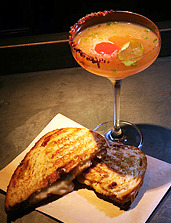 Grilled Cheese Martini Soon to Debut  Imagine soaking six piping hot sandwiches in 10 gallons of vodka, leaving the blend to marinate for 24 hours. Then pressing the sandwiches through cheesecloth to extract the infused liquid before freezing and skimming it. Hope it tastes better than it sounds.