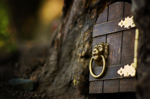 "A Little Bit of Magic  This is a 6-inch tall door at the bottom of a tree at Lake Harriet in Minneapolis. People of all ages leave around 1500 notes behind the door every year, and every single one of them is answered. Each reply ends with, ""I believe in you."" No one has seen the elf, but he's known as ""Mr. Little Guy""  Really, I need someone to tell me that now.."