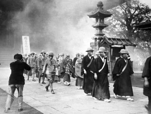 Buddhist monks training with gas masks in case of a gas attack during the Second Sino-Japanese War. Tokyo, Japan - May 30, 1936.