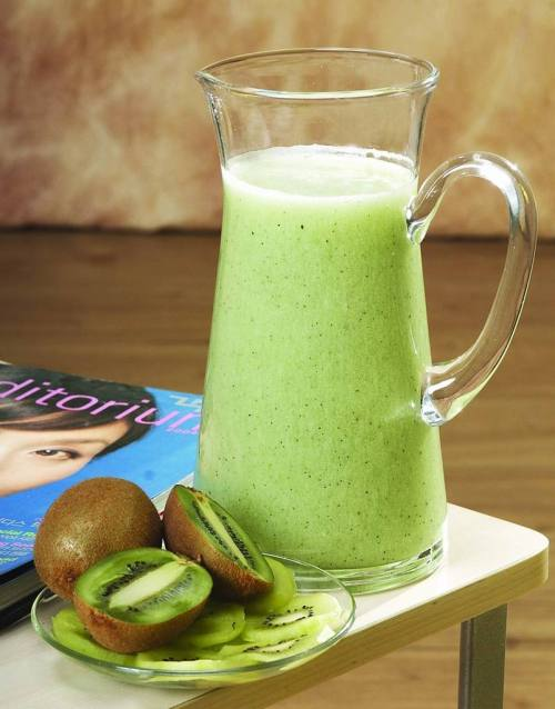 yogi-health:  Health Benefits of Raw Kiwi Fruit Juice: Kiwi fruit, originated from China, is one of the top healthy fruits. Kiwi fruit is rich in vitamins, minerals and protective phytochemicals that promote health and longevity of human life. Raw Kiwi Fruit Juice Nutritional Value Kiwi fruit is a rich source of vitamin C. It is also an excellent source of vitamins A and E, phosphorus, magnesium, potassium, and copper. Raw kiwi juice contains folate and the amino acid L-arginine. Health Benefits of Raw Kiwi Fruit Juice Raw kiwi fruit juice reduces high blood pressure and regulates heart beat. Being rich in Vitamin C, raw kiwi fruit juice boosts our immune system, helps with iron absorption, and the prevention of anaemia. Raw kiwi juice helps to enrich your diet with valuable antioxidants that protect cells from free-radical damage. Raw kiwi juice improves eyesight. Raw kiwi juice supports energy metabolism and nerve function. Folate, or folic acid, plays an essential role in making new body cells and is essential for women planning pregnancy and during pregnancy. Raw kiwi fruit juice aids our fluid balance. L-arginine helps to keep the liver, skin, joints, and muscles healthy. Raw kiwi fruit juice promotes respiratory tract health. Kiwi juice is often combined with strawberry juice. It can be also mixed with any other your favorite juice. Consume ½ glass of raw kiwi fruit juice for health benefits daily!