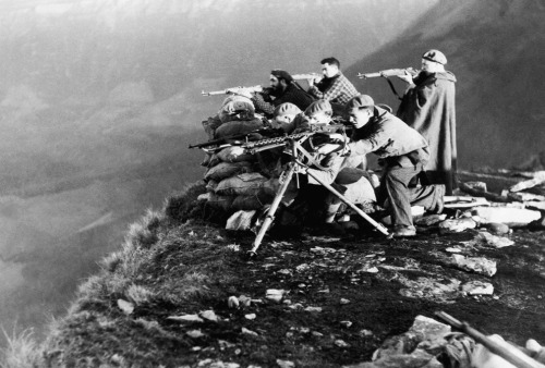 A Nationalist gun squad defending a hill in Northern Spain against Republican forces during the Spanish Civil War. December 30, 1936.