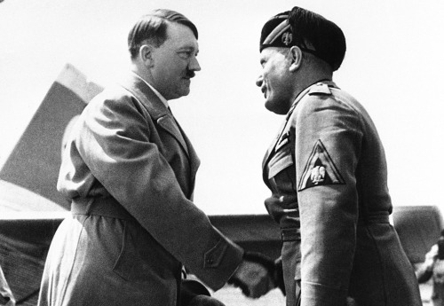 Hitler and Mussolini meeting for the first time. Hitler was embarrassed about his appearance - he arrived to the meeting in civilian clothes, while Mussolini wore a full military uniform. Venice, Italy - June 14, 1934.