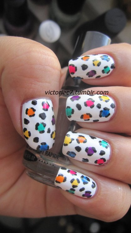 victoriac7:  I wanted to do something colorful! Colors used: Jordana - Black Sally Hansen Insta-Dri - Lightening Sally Hansen X-treme Wear - White On Essie - Bermuda Shorts China Glaze - Papaya Punch China Glaze - Flying Dragon China Glaze - Turned Up Turqoise China Glaze - Blue Sparrow  LOVE IT!!