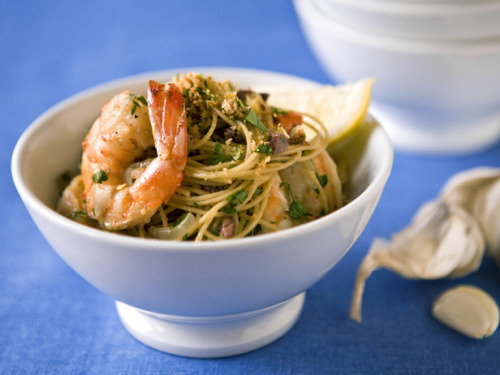 Scampi  Ingredients      6 ounces multi-grain spaghetti     1/4 cup multi-grain croutons, crushed     1/4 cup chopped fresh flat-leaf parsley     1 1/2 tablespoons grated lemon zest     1 tablespoon olive oil     1 shallot, thinly sliced     1 garlic clove, minced     1/4 teaspoon crushed red pepper     3/4 pound large shrimp, shelled and deveined (about 16 large shrimp, 21 to 25 count)     1/4 teaspoon salt     1/4 cup low-sodium chicken broth     1/4 dry white wine     1 tablespoon lemon juice     6 black pitted and chopped olives such as kalamata (about 1 tablespoon)  Directions  Cook the spaghetti according to package directions. Drain; set aside.  Meanwhile, combine the croutons, 1/2 tablespoon of the parsley, and 1 tablespoon of the zest in a small bowl; set aside.  Heat the oil in a large nonstick skillet over medium heat. Add the shallot, garlic, and red pepper. Cook, stirring until the shallots are soft, about 1 minute. Add the shrimp and the salt, and cook, over medium-high heat, turning occasionally, until the shrimp are opaque, 1 to 2 minutes. Stir in the broth, wine, lemon juice, and olives. Bring to a boil and cook for 1 minute, then reduce the heat to medium. Stir in the spaghetti, the remaining 3 tablespoons parsley, and the remaining 1/2 tablespoon zest, tossing to coat well; remove from the heat.  Transfer to a large bowl. Sprinkle with the crouton mixture. Serve at once.