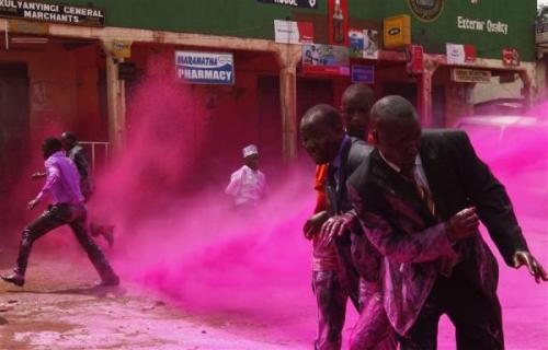 kilele:  Anti-riot police officers use coloured water to disperse opposition  supporters in the Kireka area on the outskirts of Kampala, Uganda August 17,  2011. Ugandan police fired teargas and water cannon to disperse  opposition supporters who had gathered in a Kampala suburb on Wednesday  to mourn people killed during demonstrations earlier this year,  witnesses said. Photo by REUTERS/James Akena