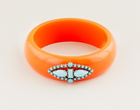 Bright and sparkly! This Lulu Frost for J.Crew red/orange resin and turquoise stone bangle, $68, is an instant mood-lifter. Available at jcrew.com.