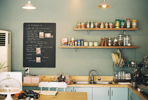 Cute kitchen with a chalkboard.