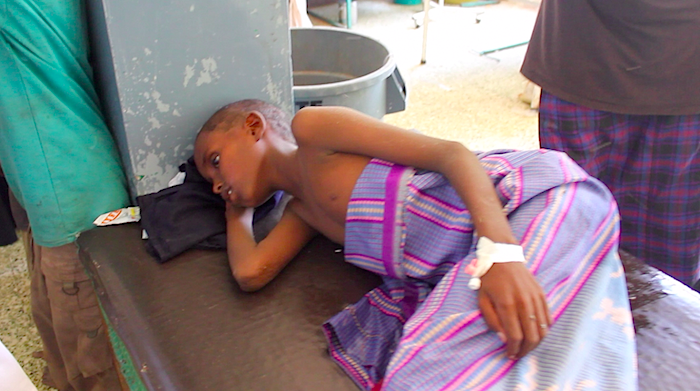 newsflick:  13 year old Ali, is fighting for his life with a sever case of cholera at the Banadir Hospital; the biggest in Mogadishu. His mother couldn't get the necessary medical attention and has fallen victim. To make matters worse his father has abandoned him at the hospital. ©newsflick