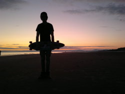 withheartsasideourhorses:  After a long day Longboarding, i go on the beach and watch the sunset while listening to Radical Face - Welcome Home <3Yep.That was a good day.
