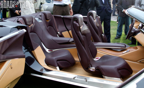"""Spirit of the classics"" Inside the Cadillac Ciel Concept, the cabin features Italian Olive wood, machined aluminum and all  the leather you'd expect in a car of this class. A ""floating"" center  console runs from the instrument panel to the rear of the interior.  There are hidden connectivity ports for each passenger, though some of  the best bits of concept car frivolity are saved for rear occupants."