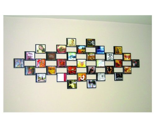 crazymadcupcake:  CD Wall Tiles. A brilliant way to display your favorite tunes and favorite covers. WANT/NEED.