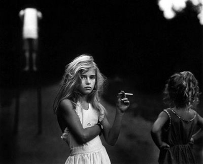 his photo, titled Candy Cigarette, not just displays something, it tells a story. It is both emotional and beautiful. This is what the originality of black-and-white-photography is all about.