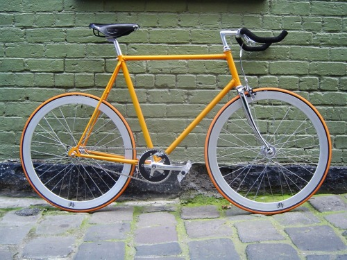 I want to build a second bike. And I want it to be similar to this one. I love that shade of orange. But with black tires. Keep the white deep-vs. And with black riser handle bars. And preferably a 47cm-48cm. Just so I can have more control.