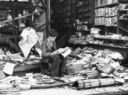 wolfcrown:  A young British boy reading outside the ruins of a bookshop after suffering bomb damage during the Blitz. London - October 8, 1940.