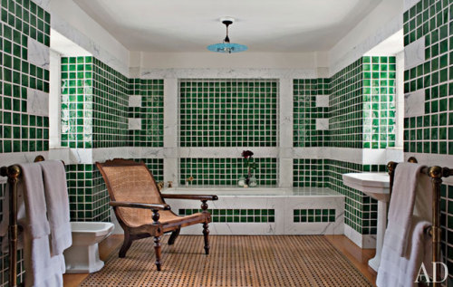 In the tiled bathroom, the handblown-glass ceiling light by Lutyens Furniture & Lighting is a reproduction of the original.