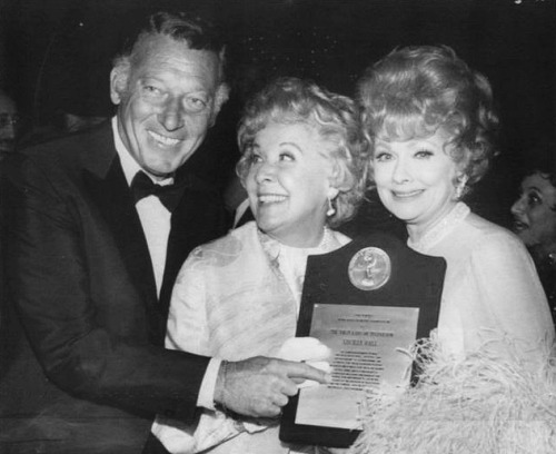 "Lucille Ball holds the plaque proclaiming her ""The First Lady of Television"" which was presented to her at the 14th Annual banquet of the Academy of Television Arts and Sciences.  (Oct. 27, 1969)"