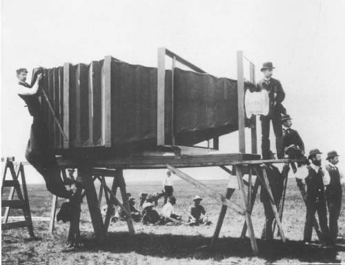 It was in 1900, when this camera was constructed to take photo of trains with dimension of 8 x 4.5 feet. The cost was $5000, a lotta money in that time. This camera used two specially made Zeiss lenses, namely 5.5 feet (1700mm) equivalent focus wide lens and 10 feet (3000mm) telescopic rectilinear lens. I do not know about the sharpness and vignetting of the lens, which becomes visible on big photograph plates, but to make this camera was a big feat indeed.  (via The Mammoth Camera of George R. Lawrence)