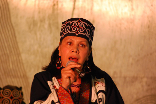universalbeauty:  Ainu woman singing lullaby. Ainu are ethnic group in Japan and eastern Russia. 'The Ainu (アイヌ?), also called Aynu, Aino (アイノ), and in historical texts Ezo (蝦夷), are indigenous people or groups in Japan and Russia. Historically they spoke the Ainu language and related varieties and lived in Hokkaidō, the Kuril Islands, and much of Sakhalin. Most of those who identify themselves as Ainu still live in this same region, though the exact number of living Ainu is unknown. This is due to confusion over mixed heritages and to ethnic issues in Japan resulting in those with Ainu backgrounds hiding their identities. In Japan, because of intermarriage over many years with Japanese, the concept of a pure Ainu ethnic group is no longer feasible.[3] Official estimates of the population are of around 25,000, while the unofficial number is upward of 200,000 people.[1]'- Wikipedia.org