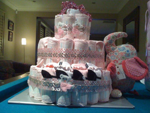 Nappy cake, hand made by me for my best friends bubba shower yesterday. And for the record, it wasn't on a lean, that's just my awesome photography skills. (Baby mumma, now you can use this instead of random photos from the Internet!) 'recipe' to follow soon.