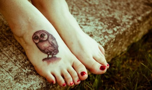 This is my newest tattoo. It's an owl from the cover art of the British edition of Harry Potter and the Goblet of Fire. I absolutely love it, the series was a big part of my life as well as a major contributer to youth literacy. Done at Slave to the Needle in Ballard, WA. Photo by Kaylyn Beauprey.