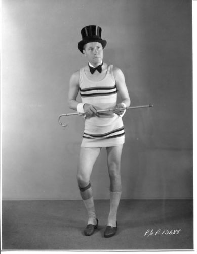 blackandwtf:  1920s A man dances in a mini-skirt and top hat.