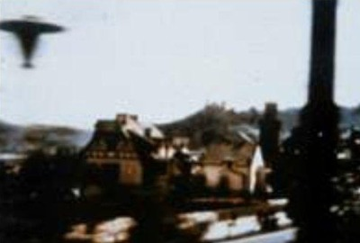 huntylch:  Oberwesel, Germany UFO (March 8, 1964)  Photographed by Harry Haukler, who was on a train passing through Oberwesel, Germany, when he saw a disc rise into the air alongside the train. The photograph shows a dark whirling below the disc.