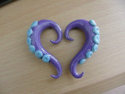 pluggitup:  0G Purple tentacle plugs with blue suction cups.Custom plugs for sale!