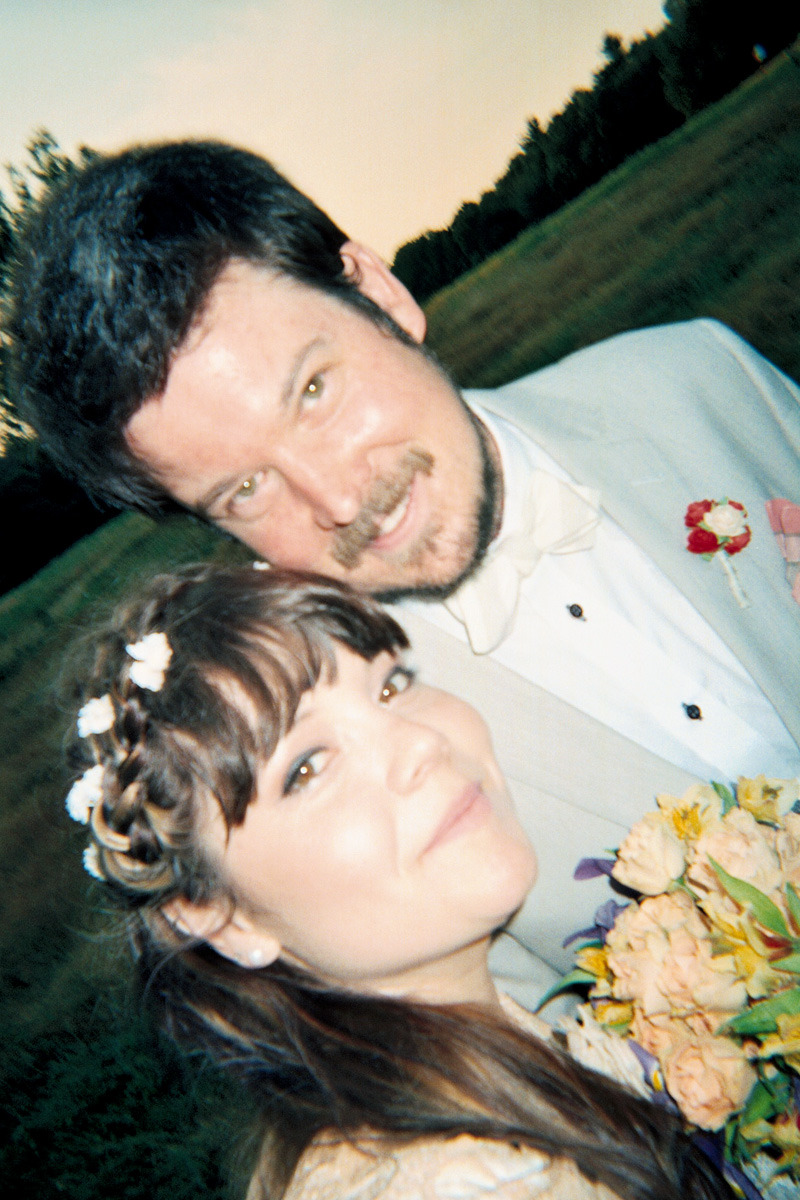 At my wedding I was handed a disposable camera. My goal was to finish taking them in 10 min. You can tell my day was a blurry heaven.  [disposable camera shots by the bride]