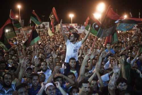 "fyeahafrica:  Libyan Uprising News Update: (via thedailywhat)  Live Updates: CNN, NYT, BBC, Guardian, SkyNews, Al Jazeera, Breaking News. Background: After months of skirmishes throughout Libya between rebel forces and Gaddafi loyalists, the National Transitional Council officially began its ""End Game"" assault on Tripoli. The Battle of Tripoli, codenamed ""Operation Mermaid Dawn"" in reference to Lybia's renown as the ""Mermaid of the Mediterranean,"" was launched last night following the successful rebel costal offensive, which saw anti-Gaddafi forces seize control of strategic cities, most notably Zawiya, effictively cutting off loyalist supply and escape routes. Rebels staged an uprising inside the Libyan captial to coincide with the anniversary of the legendary Battle of Badr, quickly taking over several neighborhood with little resistence. Rebel forces advancing from east and west entered the city this evening and were met with cheers, celebratory gunfire as they made their way toward the city center (see video below).     Latest updates: According to the National Transitional Council, two of Gaddafi's sons, Saif al-Islam and Al-Saadi, have been captured by the rebels; ICC confirms Saif al-Islam detained; reports have also surfaced that Gaddafi's son Muhammad has surrendered. Gaddafi: ""We will fight to the last drop of blood""; audio messages attributed to Gaddafi broadcast on Libyan state TV call for Libyans to ""save Tripoli,"" rise up in arms against the rebels; government spokesman Moussa Ibrahim claims 1,300 killed 5,000 wounded in last 12 hours, blames NATO; NATO SecGen: ""The [Gaddafi] regime is clearly crumbling."" Libyan government calls for immediate ceasefire talks; NTC approves talks on condition that Gaddafi step down; Gaddafi's presidential guard reportedly surrenders; rebels claim all Tripoli under their control save for Gaddafi's Bab al-Aziziyah compound; below: rebels reach Green Square (Martyrs' Square), massive celebration erupts.     Al Jazeera: African Union may offer Gaddafi exile in Angola, Zimbabwe; NTC: ""We want to see Gaddafi put on trial in Libya."" [photo: aje.]"