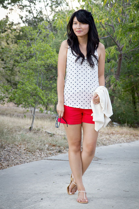 "2011. summer skin.  joie alicia tank in cadet dots. forever 21 shorts. shortcut sweater by j.crew. corso como sandals. the past few days have been a whirlwind! i ended up working late on both thursday and friday— too late for outfit photos. on saturday night, M and i went out for sushi, and i broke out some red shorts. i'd love to tell you that the shorts are thrifted (like so many of my shorts), but i bought them from forever 21. i altered the hemline by using a seam ripper and ironing out the cuffs. now they're more lady-in-red and less ""that girl."" what's your favorite kind of sushi? i love spider rolls (soft shell crab rolls) and anything spicy. the look 