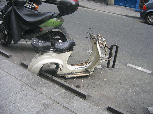 scooter pic of the day: in cities everywhere, it's common to see an unfortunate bike that has been stripped of its seat and wheels. it's even sadder to see it happen to a scoot.