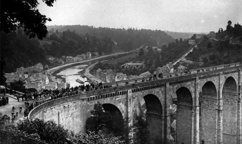 Classics of the Tour de France - '1922 Tour de France: Racing over the bridge at Dinan, Brittany'