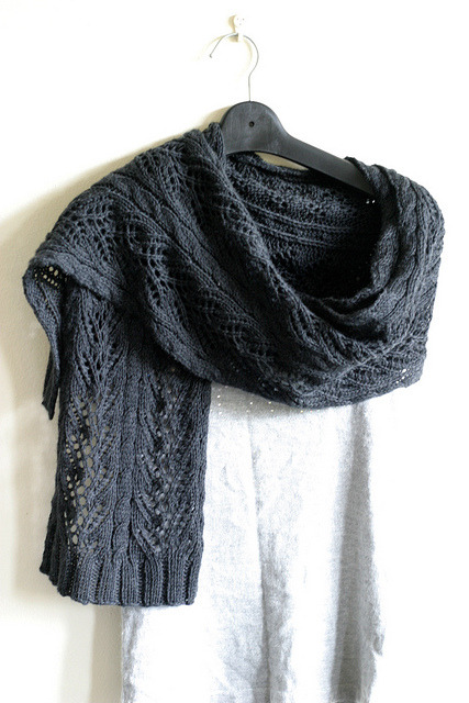 Pattern | Vogue Knitting Holiday 2010, #24 Vine Lace Scarf by Simona Merchant-Dest Yarn |  Lincraft Premium Italiano Woolight Merino (6 Balls X 50g) Colourway | Charcoal This was knit for a friend … she goes travelling to NYC in October. The merino was waxy to the touch when I was knitting, but since washing and blocking it has bloomed into a stunning soft, cuddly scarf. I am not a fan of knitting with charcoal, but the result is enough for me to be tempted to put up with the pain. :)