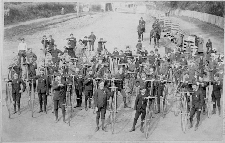 "afrormosia:  ""A large group of cyclists from the Waitemata Cycling Club standing  beside their Penny Farthing bicycles, two men on horseback behind."" (Sir George Grey Special Collections, Auckland Libraries, 7-A6730.)"