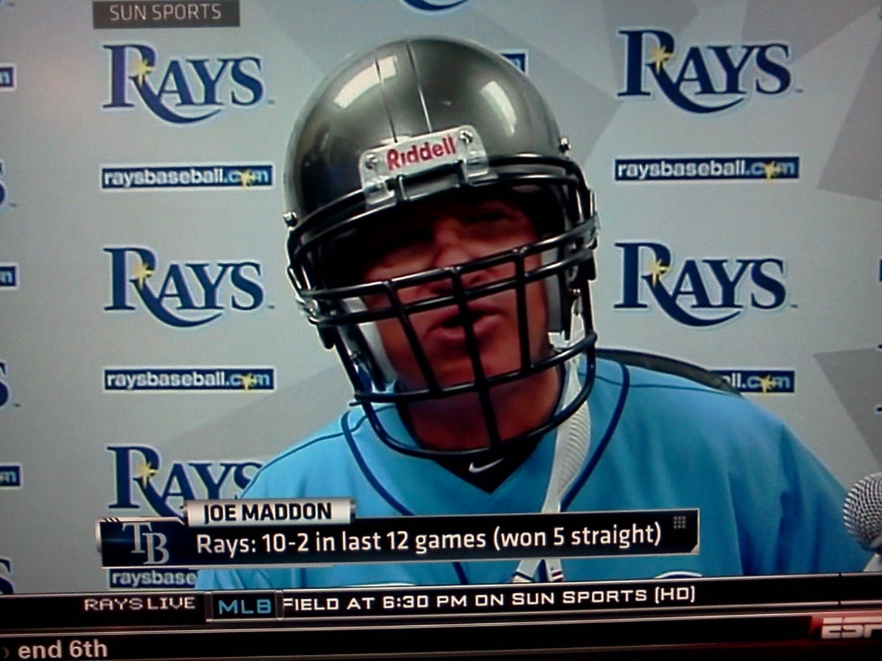 inothernews:  Tampa Bay Rays manager Joe Maddon, wearing a Bucs helmet during the post-game presser in solidarity with his town's NFL team.  I love Maddon so much. He is so wonderfully St. Pete.